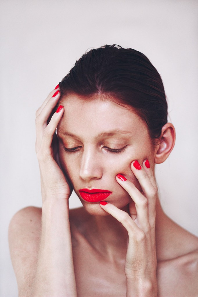 Beauty portrait of woman with red lips and nails