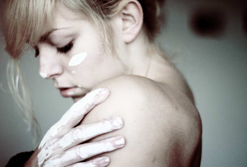 Emotional portrait with white painted hands. Photograph by Noukka Signe.