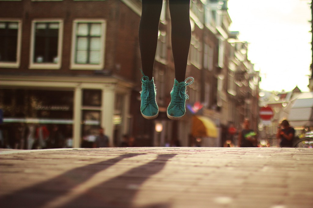 Feet jumping in Amsterdam by Noukka Signe
