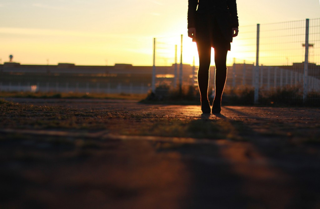Girl standing in Berlin Tempelhof at sunset