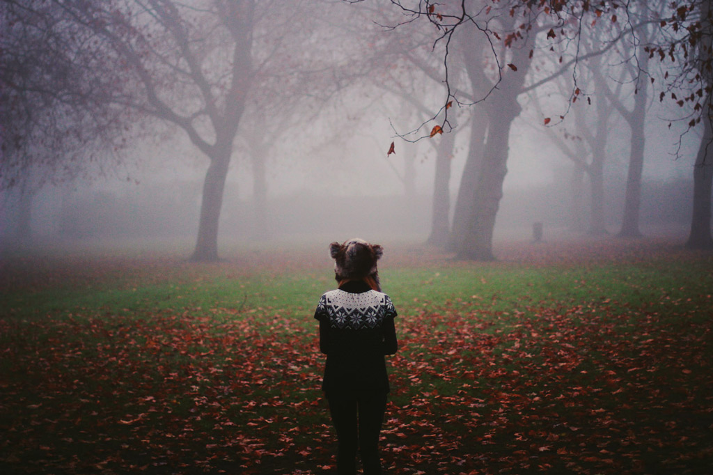 Girl standing in a misty park - Photograph