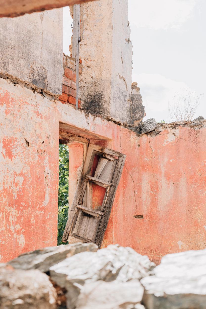 Broken window in Gairo ghost town