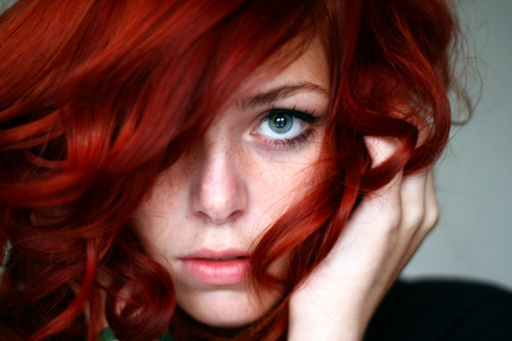 Expressive selfportrait with bright red curled hair