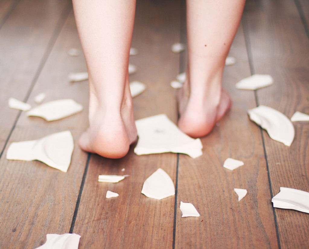 Feet walking among porcelain shards